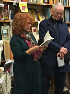 Libby Sommer reading from her book while Stephen Matthews listens